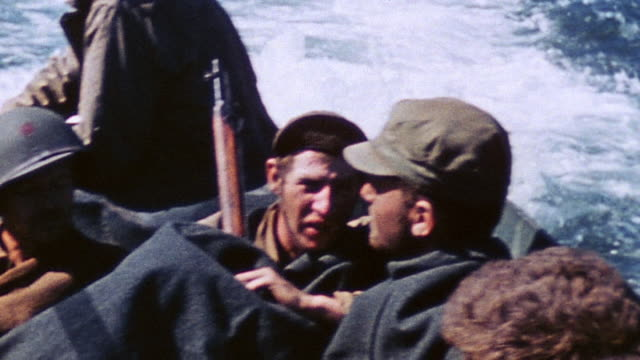 pov riding in dukw with walking wounded casualties from the battle from the island to a hospital ship offshore / iwo jima japan - schlacht um iwojima stock-videos und b-roll-filmmaterial