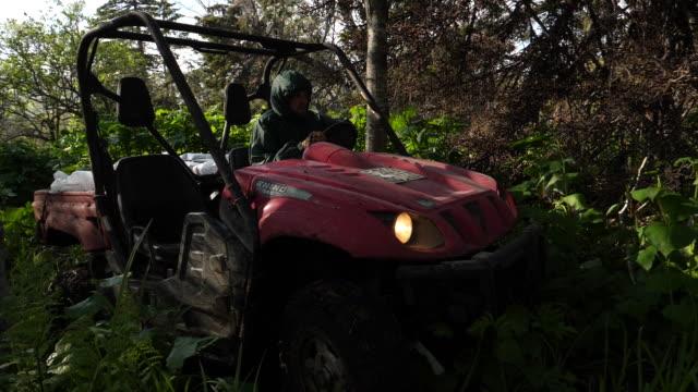 atv riding in kunashir island (kuril islands) - quadbike stock videos & royalty-free footage