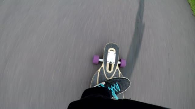 pov riding longboard on road, bavaria, germany - skateboard stock videos & royalty-free footage