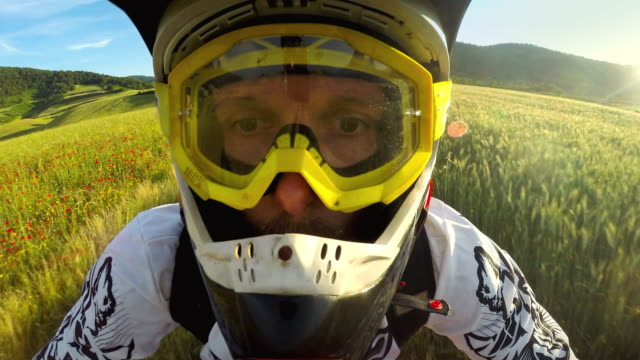 pov riding motocross enduro bike outdoor - helmet stock videos & royalty-free footage