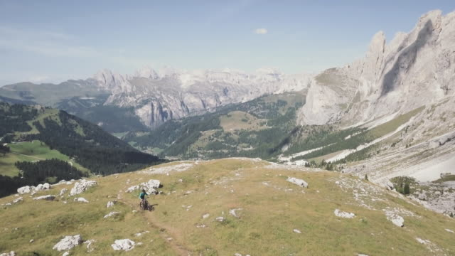 Riding mountainbike bicycle on Dolomites: drone aerial view
