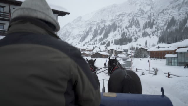 pov of riding on a horse sleigh on the snow in winter. - ski resort stock videos & royalty-free footage