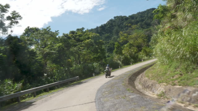 fpv: riding on the ho chi minh road - moped stock videos and b-roll footage