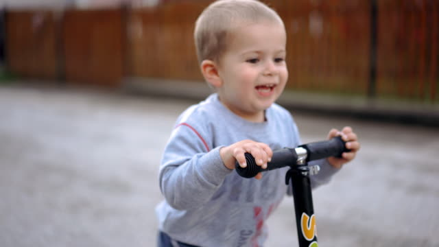 riding on the scooter - one baby boy only stock videos & royalty-free footage