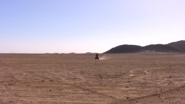 riding quad at the desert - quadbike stock videos & royalty-free footage