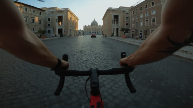 pov riding: road bicycle in the city of rome near saint peter square - st peter's square stock videos & royalty-free footage