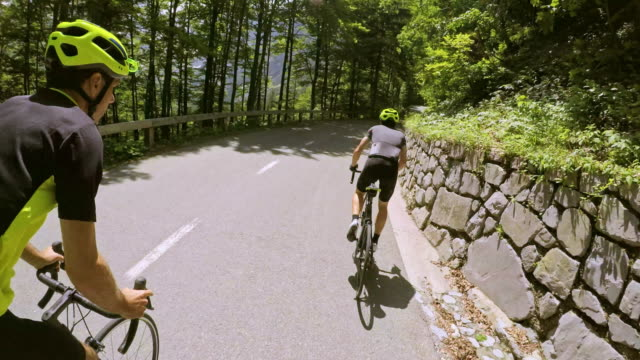 POV Riding road bikes up a mountain road