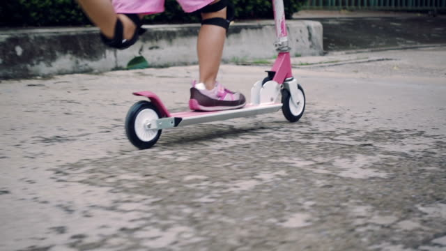 riding scooters - push scooter stock videos and b-roll footage
