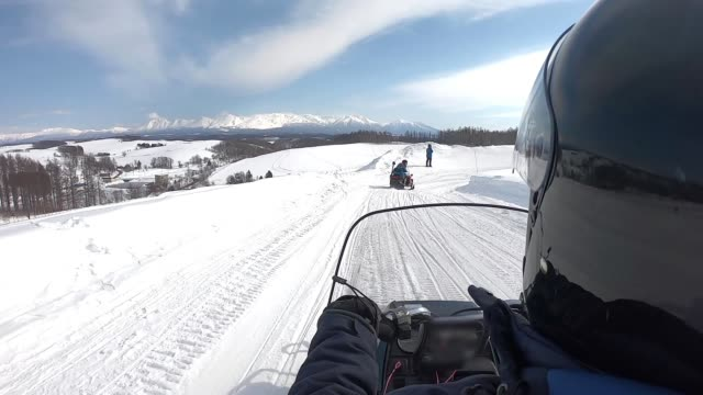 riding snowmobile in mountains. - mode of transport stock videos & royalty-free footage