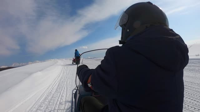 riding snowmobile in mountains. - crash helmet stock videos & royalty-free footage