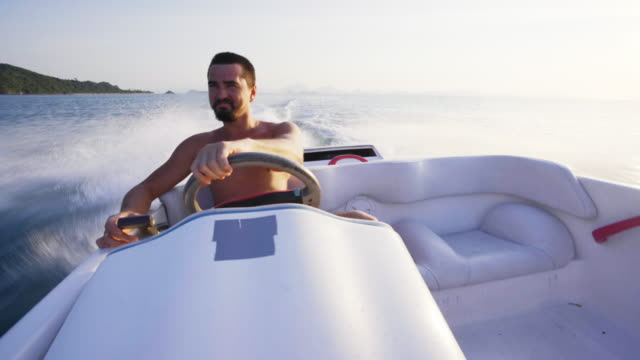riding speedboat 4k - power boat stock videos & royalty-free footage