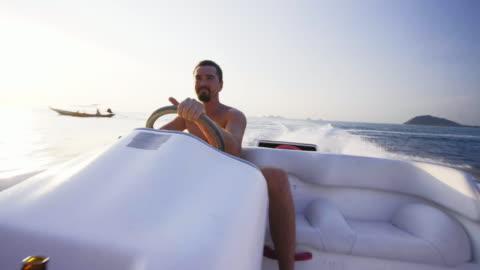 riding speedboat 4k - speed boat stock videos & royalty-free footage