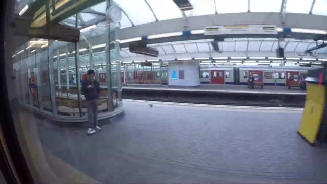 riding  subway in london - underground station platform stock videos & royalty-free footage
