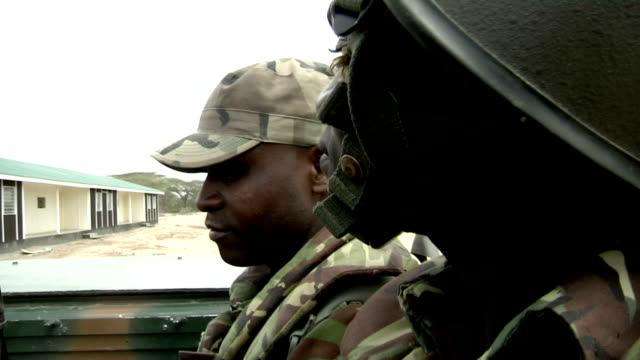 riding through the savanna Kenyan soldiers on truck on July 31 2011 in Kenyan/Somali border Kenya