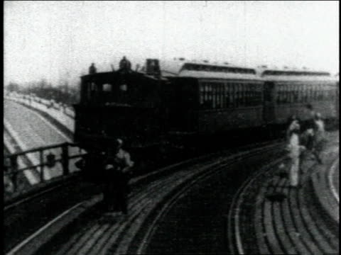 1904 pov riding train down track as another train passed going in opposite direction on track / new york city, new york, united states - 1900~1909年点の映像素材/bロール