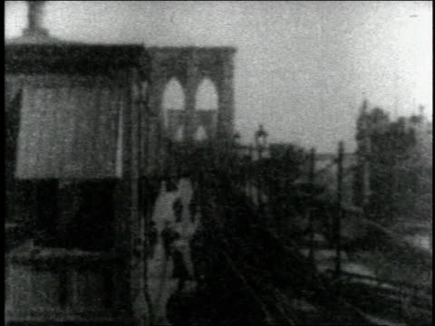 1904 ws riding train tracks through city from covered station / new york city, new york, united states - 1904 stock videos & royalty-free footage