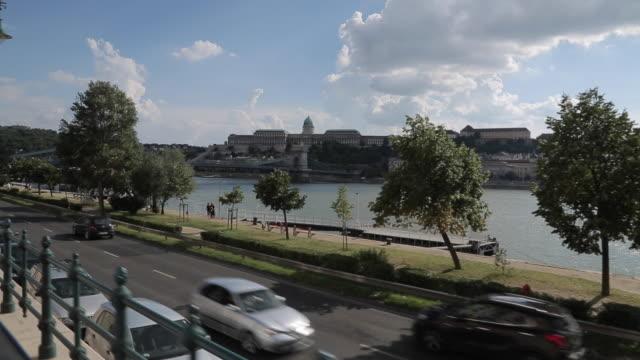 vídeos de stock, filmes e b-roll de riding tram on danube riverside, budapest, hungary, europe - ponto de vista de bonde