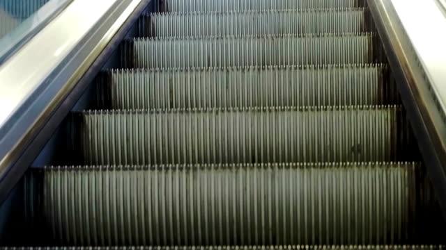 Riding up an escalator