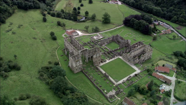 rievaulx abbey  - aerial view - england, north yorkshire, ryedale district, united kingdom - abbey stock videos & royalty-free footage