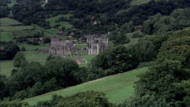 rievaulx abbey - aerial view - england, north yorkshire, ryedale district, united kingdom - abbey monastery stock videos & royalty-free footage