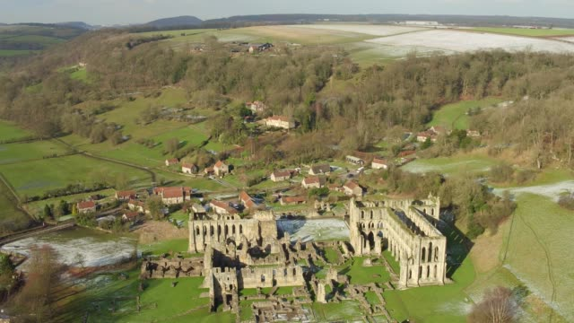 rievaulx abbey in winter aerial video - tracking down - abbey monastery stock videos & royalty-free footage