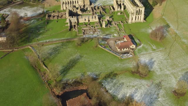 Rievaulx Abbey in Winter Aerial Video - Tracking Up