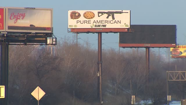"""rifle company has placed a billboard featuring a baseball mitt, an apple pie and an assault rifle over the words """"pure american"""" raising controversy... - design element stock videos & royalty-free footage"""