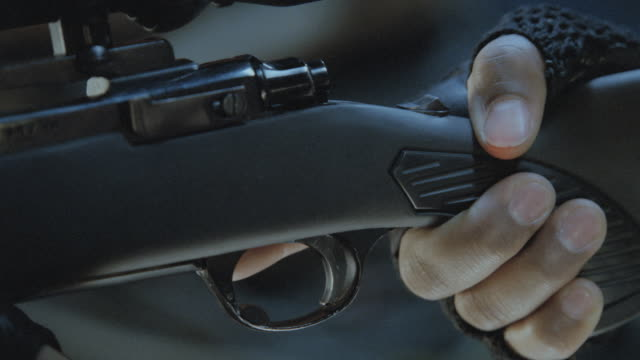 a rifle fires. - trigger stock videos & royalty-free footage