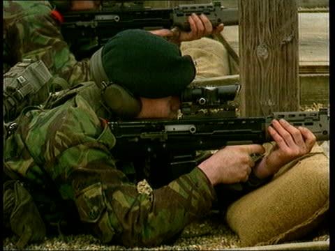 rifle - misfiring claims; lib warminster: soldiers firing sa80 rifle on firing range lib saudi arabia: british soldiers in trench in desert with sa80... - krishnan guru murthy stock videos & royalty-free footage