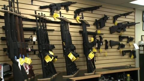 rifles at a gun store on october 01, 2013 in san diego, california - 銃器店点の映像素材/bロール