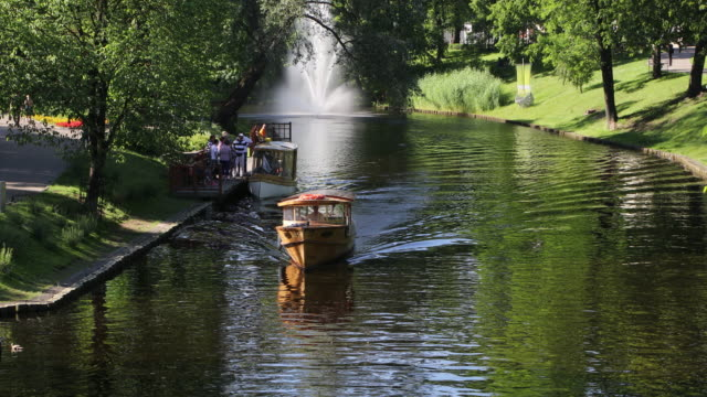 riga, sailing in the canals of the city. - baltic countries stock videos and b-roll footage