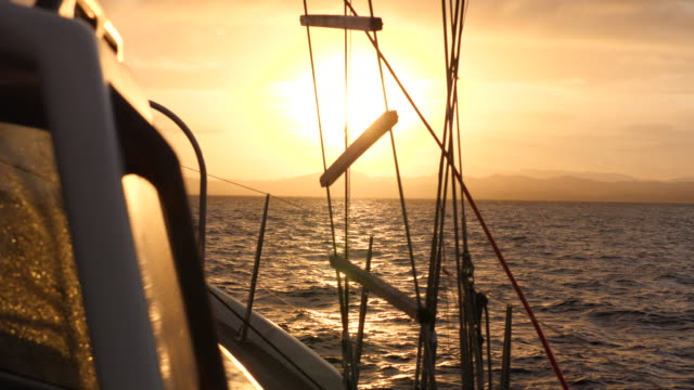 rigging close-up details at sunset on a sailboat boat in the pacific ocean. - slow motion - marinaio video stock e b–roll