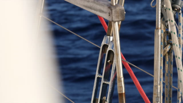 rigging close-up details on a sailboat boat in the pacific ocean. - slow motion - mast sailing stock videos & royalty-free footage