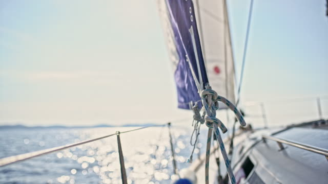 4k rigging knot on sunny sailboat, real time - rigging stock videos & royalty-free footage