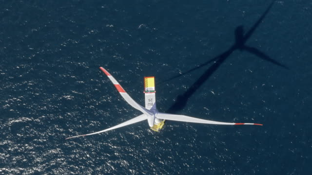 aerial right above a wind turbine at sea - turbine stock videos & royalty-free footage