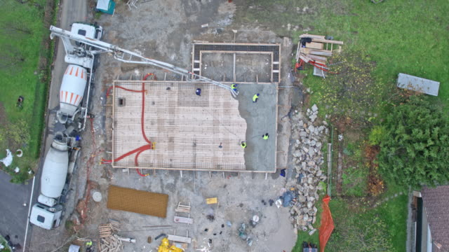 aerial right above the construction site - cement mixer stock videos & royalty-free footage