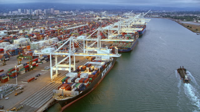 aerial right above white cranes at a shipping dock in california - ship stock videos & royalty-free footage