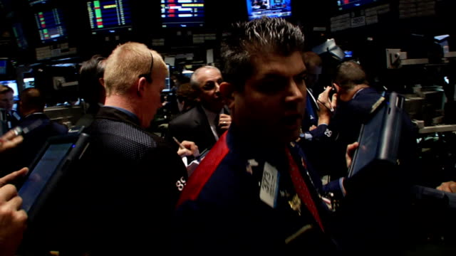 right before the closing bell eyelevel view of traders and monitors at workstation on trading floor of new york stock exchange new york city - 2008 stock videos and b-roll footage
