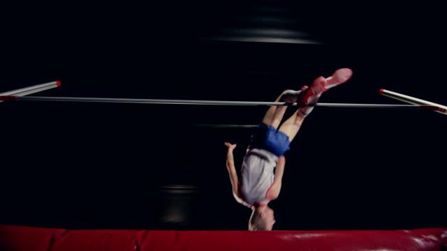 vídeos y material grabado en eventos de stock de slo mo ld right below a male high jumper jumping over the bar - atletismo