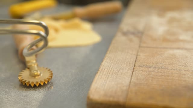 right pan across tagliatelle on wooden surface - tagliatelle stock videos and b-roll footage