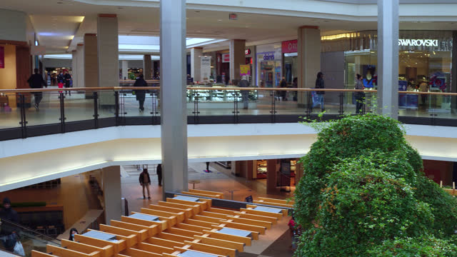 stockvideo's en b-roll-footage met right pan inside of the fairview mall during the coronavirus times on november 2, 2020; in toronto, ontario, canada. the shopping mall is almost... - plaatselijk monument