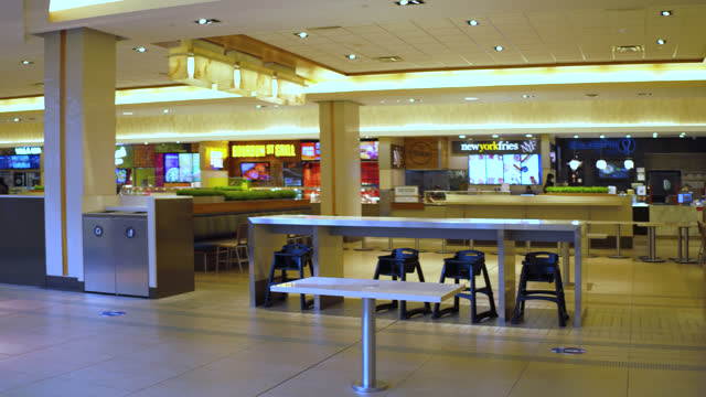 stockvideo's en b-roll-footage met right pan of the empty food court in fairview mall during the coronavirus pandemic seen on november 2, 2020; in toronto, ontario, canada. the food... - plaatselijk monument