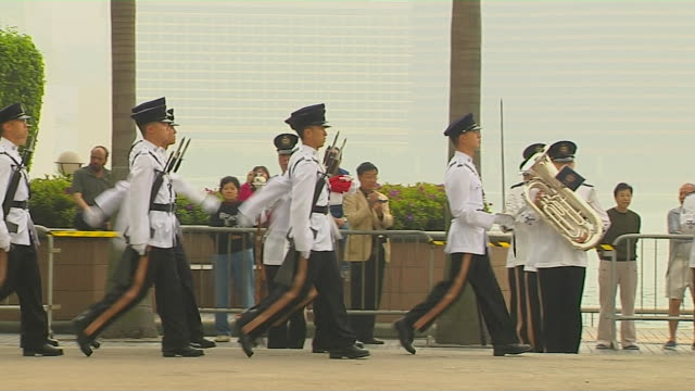 right pan soldiers parading hong kong china - military parade stock videos and b-roll footage