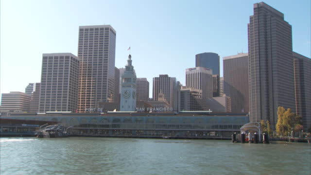 San Francisco Bay Ferry Building w/ clock tower pier w/ parked vehicles building city skyscrapers BG Landmark iconic Embarcadero urban