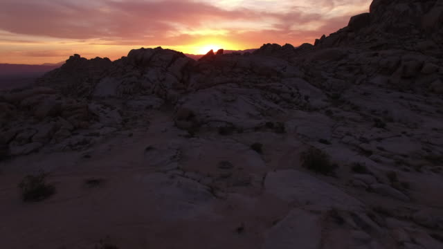 right side over rocks evening sunset 1 of 8 - drone aerial video 4k arizona, utah, moab desert, open plain, trail, adventure, discovery landscape, reveal, beautiful, prairie, sun reveal beautiful 4k sports - grass area stock videos and b-roll footage