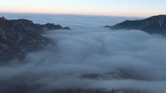 right to left aerial pan of fog and mountains - mountain range stock videos & royalty-free footage