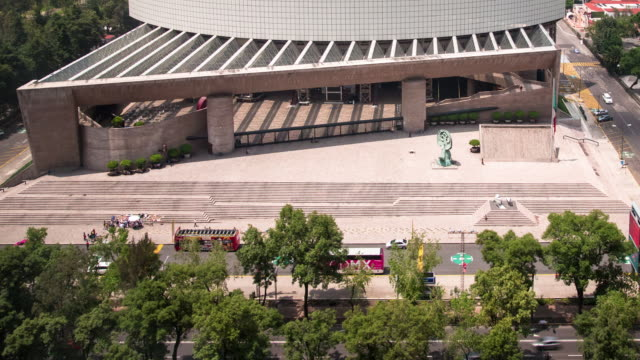 A right to left daytime time lapse of light traffic along the Paseo de la Reforma in Mexico City, with views of the Auditorio Nacional (Spanish: 'National Auditorium').