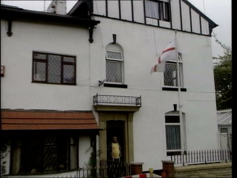 INT Tony Blair MP along to meet police officers in station Oldham EXT GV St George's Cross flag flying outside house ZOOM BV Group of men away down...