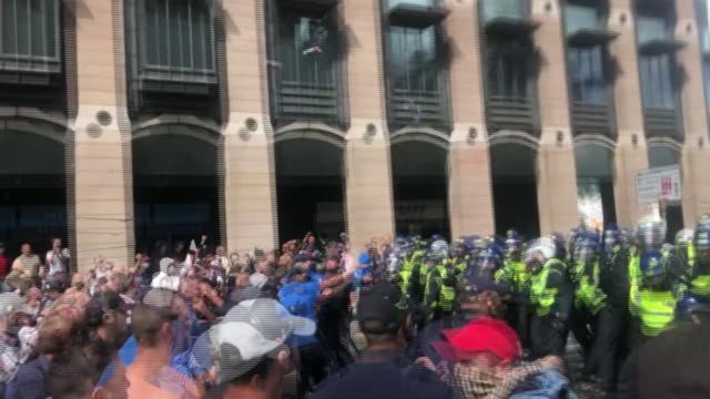 right wing protestors attacking police in london - kicking stock videos & royalty-free footage