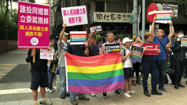 LGBT rights protesters demonstrate outside a parliamentary administration building where politicians are continuing to discuss samesex marriage bills...